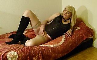 SilkeTrav wanks her limp She-Cock on the Bed